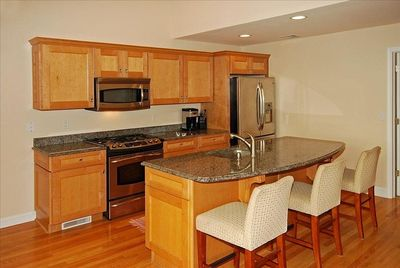granite and stainless steel kitchen
