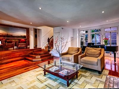 The parlor with Steinway piano leads to private garden