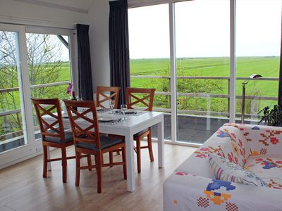 Photo for Lovely apartment with roof terrace offering panoramic views, located near Petten