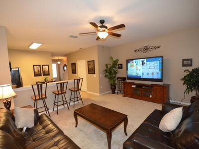 Photo for 2 Miles to Disney Luxury 3br/3ba Townhome sleeps 8, Private pool, Free Wi-fi