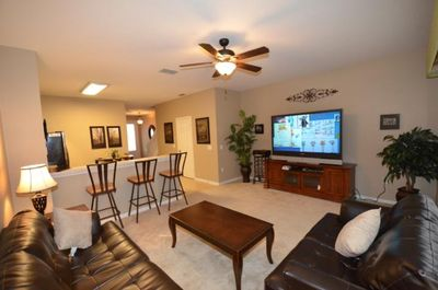 Living room with large screen tv, cable, tv, Queen-sized pull out couch