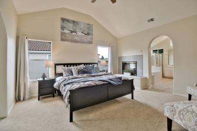 For a luxurious experience, spend your time in the master suite, complete with a king bed, two sitting areas, a desk/working space, and a large en-suite bathroom.