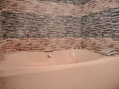 Photo for 4 Bedroom Combo 2 Hot tubs 2 apartments AC Lleras