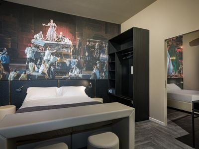 Photo for Elegant two-room apartment with a scene from an Arena opera as a theme