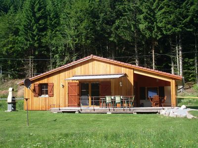 Photo for Single storey chalet on the edge of the lake on 1 hectare of virgin land with sauna
