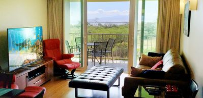 Photo for Newly Renovated! Top-Floor Gem w/ Balcony, Ocean Views & A/C - Steps to Beach