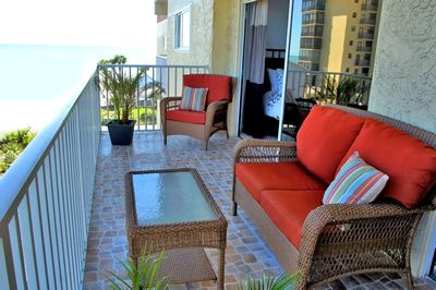 Large Balcony with Gulf and beach view on one side. Serving both bedrooms.   Large balcony with comfortable furnitures and access to living room and bedrooms  Redington Shores Beach- Absolutely Gorgeous  Sugar white sand on Redington Beach.  Sunset at t