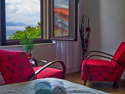 Photo for Romantic apt for 4 - private terrace, sea view and 50m from the sea
