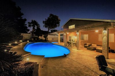 Large pool and spa, fire pit, dining table, lounging sectional and chairs, BBQ