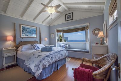 Romantic queen bedroom with window seat; wake up to ocean views