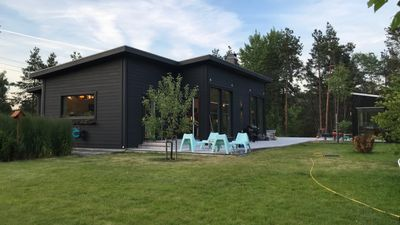 Photo for Modern Scandinavian family house by the forest and 15 minutes from Stockholm center