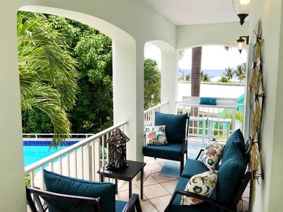 Walk to town. Poolside. View! Two master suites! Rennovated. Private Yacht!