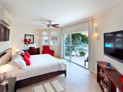 Photo for Modern Beachfront Condo with Pool - Sapphire Beach 209