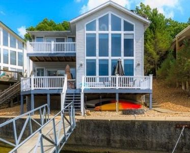 Photo for Lakefront home w/ boat slip and swim dock - Great Location - Sleeps up to 9!