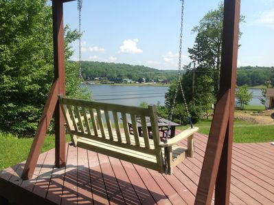 Vacation is all about location you can watching grandkids on lake from swing.