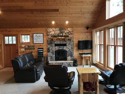 Comfortable seating in the living room with a beautiful wood burning fireplace!