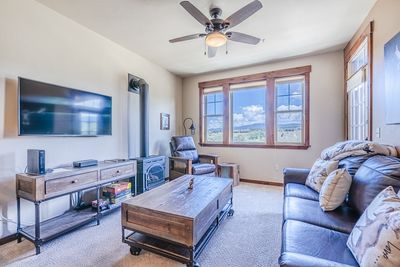 Living Area - Living Area- Flat screen TV, large window with a great view, sofa sleeper, and access to the private balcony.
