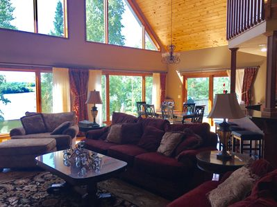 Enjoy the lake and forest from inside of the house in the spacious great room.