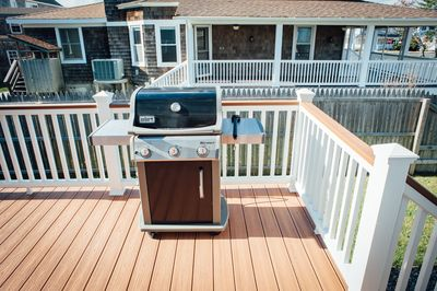 Rear deck with grill off kitchen entrance.