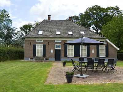 Photo for A modern renovated farmhouse from 1476 with chimney, large garden and Wifi