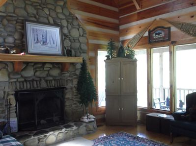 Huge river rock fireplace for winter time