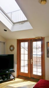 Terrace doors and living room skylight. 50 inch cable TV in living room