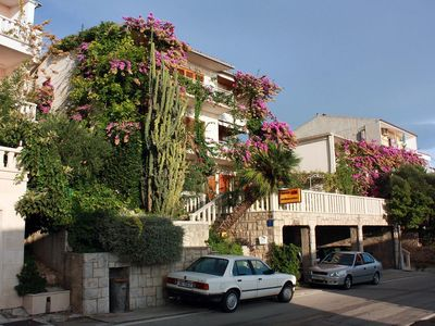 Photo for Two bedroom apartment with balcony and sea view Brela, Makarska (A-2752-b)