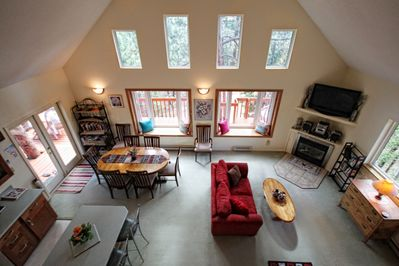 The Great Room with large bay windows and views to woodland and mountains
