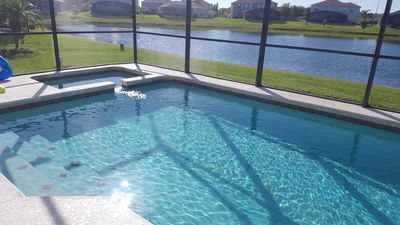 Photo for DISNEY'S FAMILY VACATION 7 BEDROOMS 4 BATHS LAKEFRONT S- FACING POOL NEAR PARKS