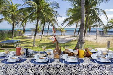 Fresh fruits, bread and coffee for breakfast with this incredible view