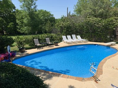 Photo for Backyard Family Oasis, Saltwater Swim Pool, Hot Tub, Game Room, BBQ's, Fire Pits