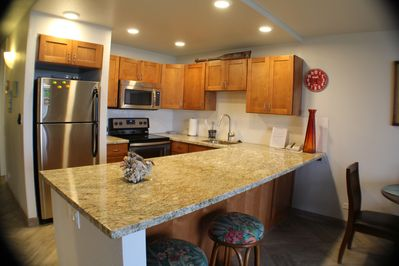 full kitchen with new appliances, granite counters and tile floors