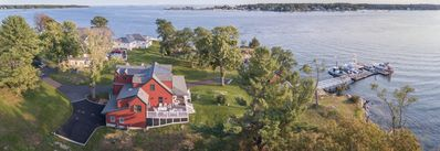 The Red cottage showing dock, boat house, main house, and view out the harbor