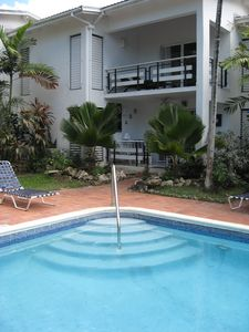 Photo for Beachfront + pool -  one bedroom stylish ground floor condo  West Coast