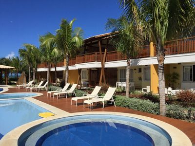 Photo for Large Village 3 suites by the sea in Itacimirim
