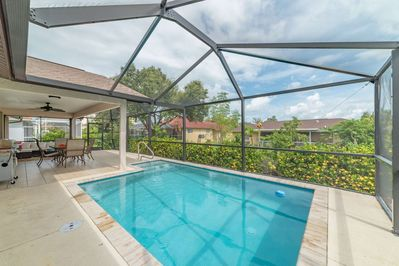 The screened in pool beckons you to take a swim....