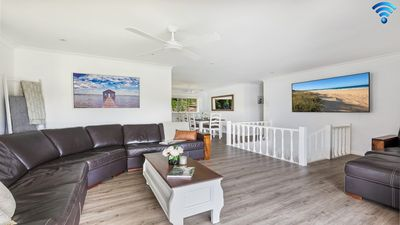 Photo for Sounds by the Sea - open plan living, metres to beach