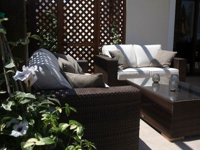 Outdoor sofas by the pool