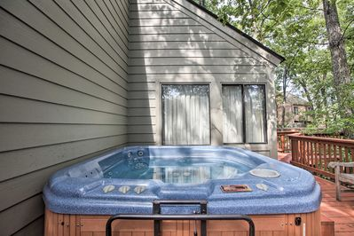 After a day on the slopes, soak your sore muscles in the private hot tub.
