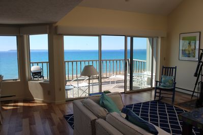 2 story living room looking out to deck, on private beach on Lake Michigan.