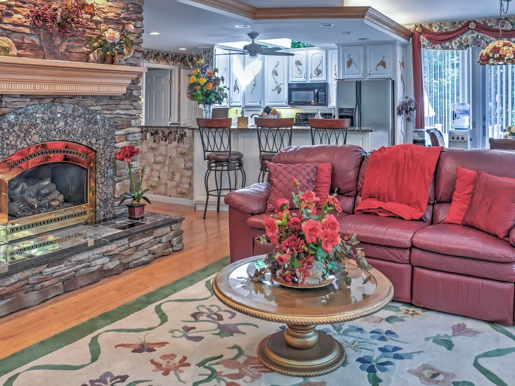 Relax And Unwind In The Spacious, Open Living Area , Complete With A  Handsome Fireplace