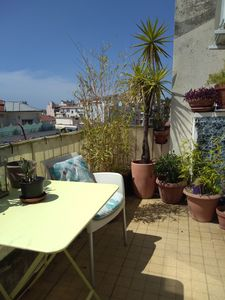 Photo for Two bright rooms on the top floor with terrace and panoramic views. clim