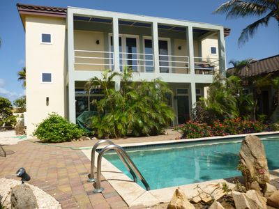 Photo for Peaceful modern villa w/pool,tropical garden, close to Palm Beach &attractions.