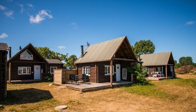 Photo for Log cabin in the resort with horse stables on the Wadden Sea