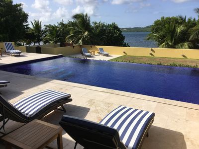 Photo for Luxurious 4 bedroom Beachfront Villa, Private pool, Close to English Harbour