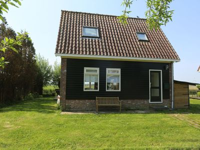 Photo for Romantic holiday home directly on the Markermeer lake with waterfront terrace