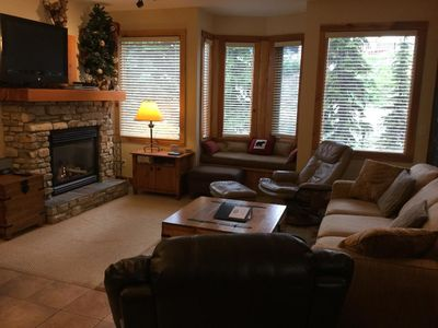 Living room with a comfy new hideabed, ample seating large Flat screen tv, wii, board games, stereo and access to private hotub and bbq.