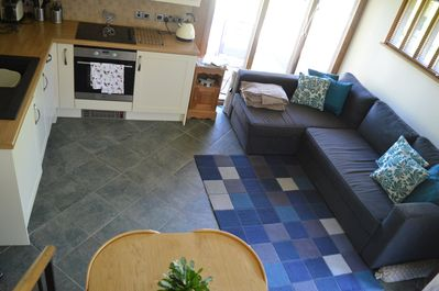 Open plan living/dining/kitchen area. large sofa bed sleeps two extra guests