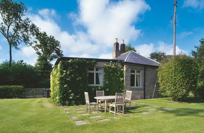 Photo for This superb Grade II listed cottage offers views of rolling countryside from the private garden.
