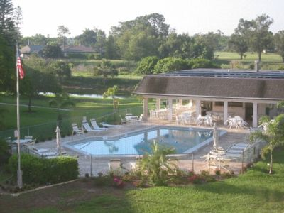 View of Pool, Clubhouse and Canal from Lanai, adjacent to Hybiscus Golf Course.